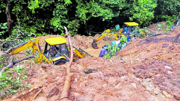 Excavators clear a section of the Charmadi Ghat which was blocked due to landslides on Tuesday.