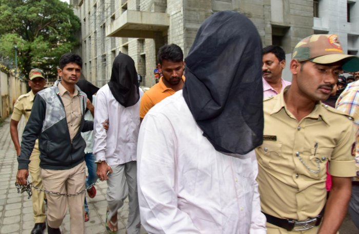 The suspects in the Prof Bhagwan case being taken to the Additional Chief Metropolitan Magistrate's Court in Bengaluru on Thursday by SIT officials, who are seeking custody to quiz them in the Gauri Lankesh murder case. DH Photo/B H Shivakumar