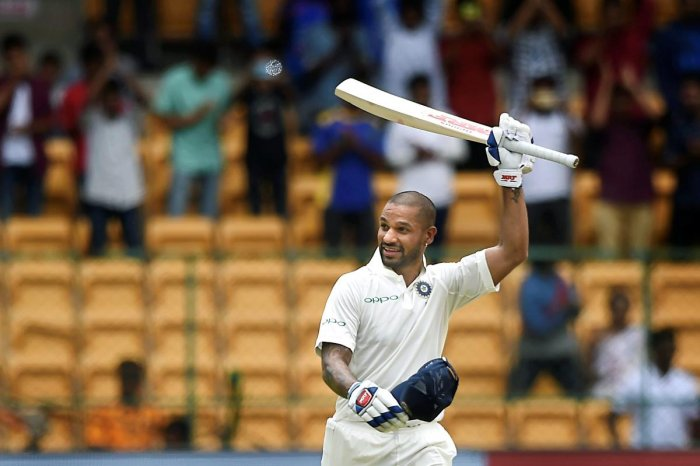 India's Shikhar Dhawan celebrates his century on the first day of the one-off cricket test match against Afghanistan, at Chinnaswamy Stadium in Bengaluru on Thursday, June 14, 2018. (PTI Photo/Shailendra Bhojak)