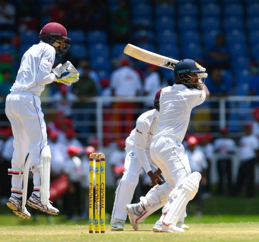 Dinesh Chandimal cuts one to the fence en route his unbeaten 119 against West Indies. AFP