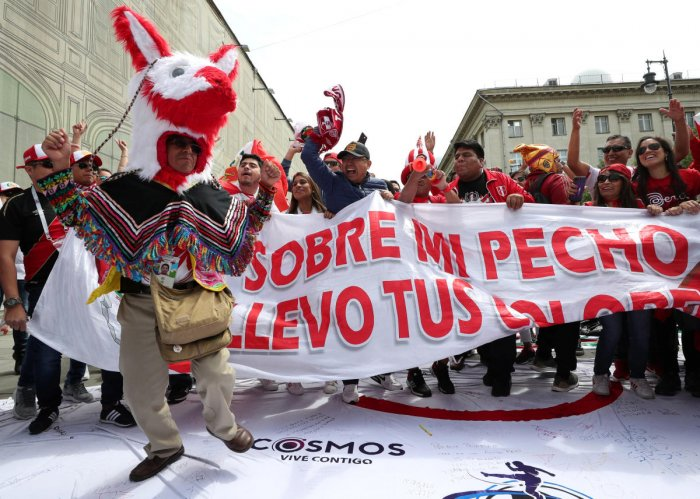 ALL FUN Fans of the Peruvian team parade on the streets. AFP
