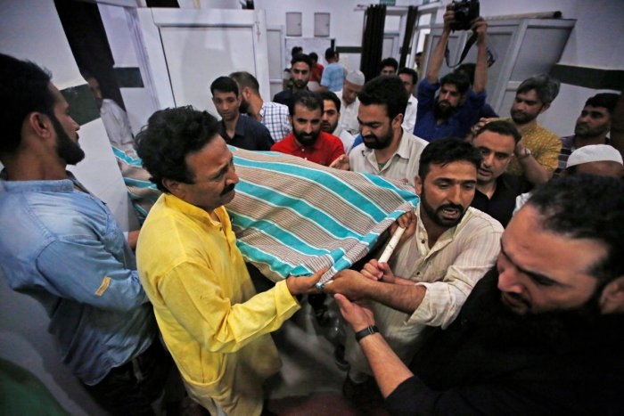 People carry the body of Syed Shujaat Bukhari, the editor of Rising Kashmir daily newspaper, who was killed by unidentified gunmen outside his office in Srinagar. Reuters photo.