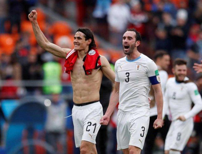 World Cup - Group A - Egypt vs Uruguay - Ekaterinburg Arena, Yekaterinburg, Russia - June 15, 2018 Uruguay's Edinson Cavani and Diego Godin celebrate after the match. Reuters photo