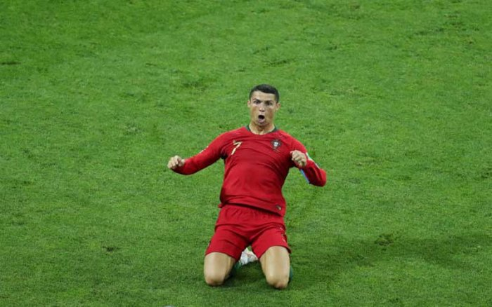 Ronaldo had twice put Portugal in front, and yet he was required to score a superb 88th-minute free-kick to grab a point after Spain had fought back brilliantly. (Reuters)