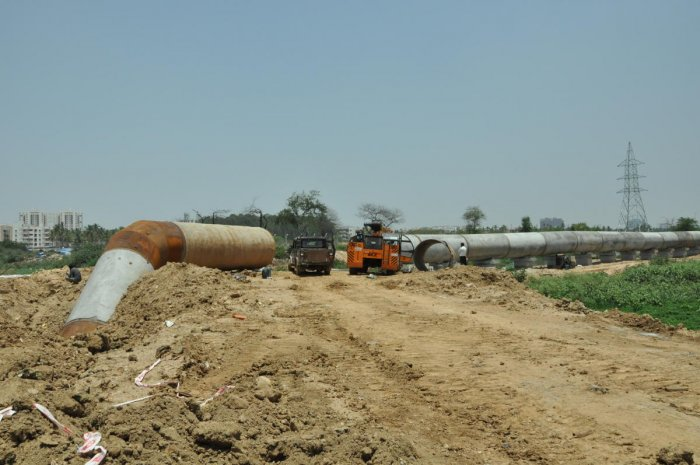 A mud road being laid through the Varthur Lake for laying a pipeline. DH FILE PHOTO