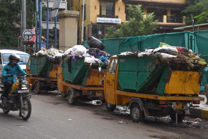 Heavy garbage is seen due to not clear in front of BSNL exchange, Bazaar street, Halasuru in Bengaluru on Wednesday. Photo by S K Dinesh