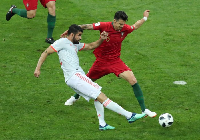 Spain's forward Diego Costa scores a goal during the Russia 2018 World Cup Group B football match between Portugal and Spain at the Fisht Stadium in Sochi on June 15, 2018.  AFP PHOTO