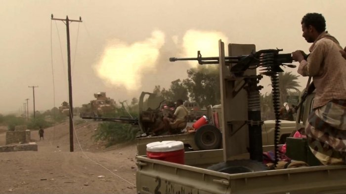 This image grab taken from a AFPTV video shows Yemeni pro-government forces firing a heavy machine gun at the south of Hodeida airport, in Yemen's Hodeida province on June 15, 2018. AFP