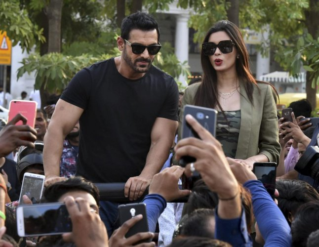 Bollywood actors John Abraham and Diana Penty during the film promotion of 'Parmanu: The Story of Pokhran', at Connaught Place, in New Delhi, on Tuesday. PTI Photo