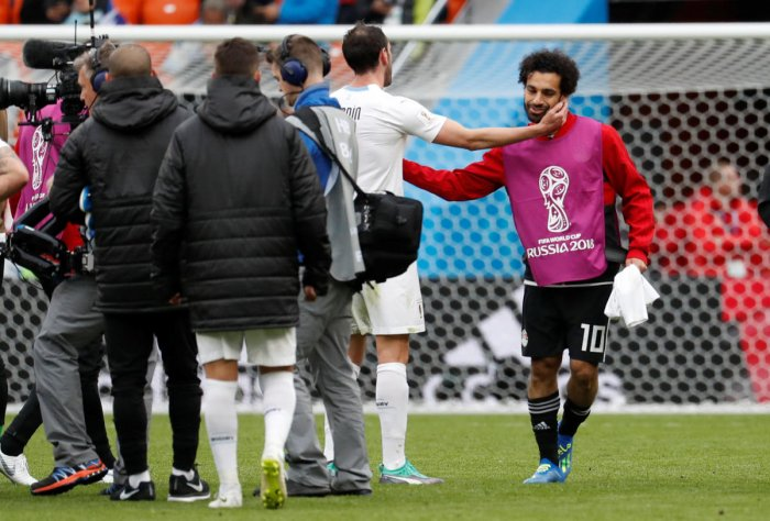 Egypt's Mohamed Salah with Uruguay's Diego Godin. REUTERS file photo.