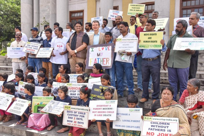 Members of Children's Rights Initiative for Shared Parenting stage a protest demanding rights for fathers on the eve of Father's Day, in front of Town Hall on Saturday. DH PHOTO/SK DINESH