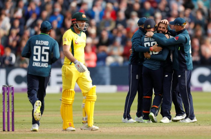 England's Moeen Ali celebrates taking the wicket of Australia's Glenn Maxwell with team mates. (Reuters Photo)