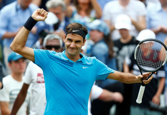Roger Federer celebrates winning the final against Canada's Milos Raonic. Reuters photo