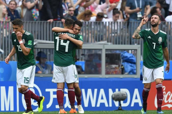Mexico's forward Hirving Lozano celebrates the opening goal with teammates during the Russia 2018 World Cup Group F football match between Germany and Mexico at the Luzhniki Stadium in Moscow. AFP PHOTO