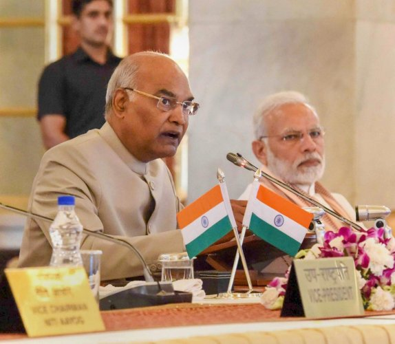 President Ram Nath Kovind speaks as Prime Minister Narendra Modi looks on, during the second day of the Conference of Governors at Rashtrapati Bhavan, in New Delhi. PTI Photo