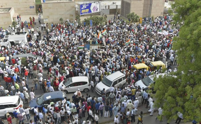AAP workers march from Mandi House to Prime Minister's residence in support of Delhi Chief Minister Arvind Kejriwal's dharna at LG's office, in New Delhi on Sunday. PTI Photo