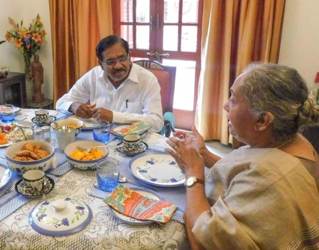 Deputy Chief Minister G Parameshwara has a chat over tea with senior Congress leader Margret Alva at her residence on Monday.