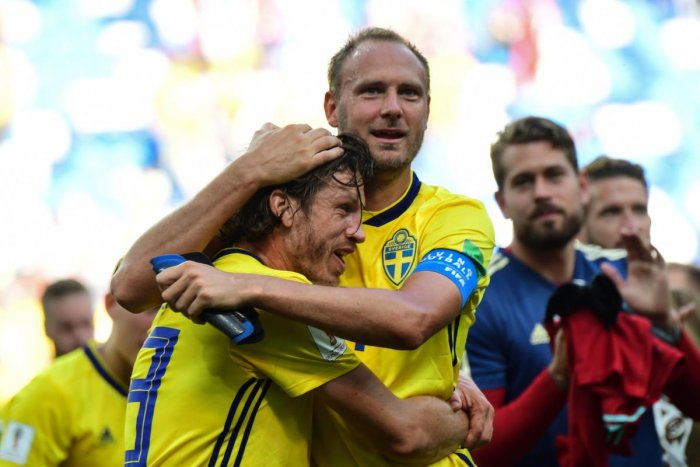Sweden's midfielder Gustav Svensson (L) and Sweden's defender Andreas Granqvist embrace following their victory during the Russia 2018 World Cup Group F football match between Sweden and South Korea at the Nizhny Novgorod Stadium in Nizhny Novgorod on Monday (AFP Photo)