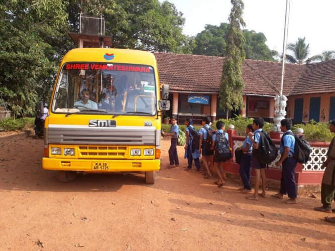 Students boarding the school bus in Vittal.