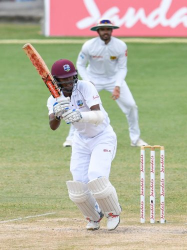 Kraigg Brathwaite of West Indies en route to his unbeaten 59 against Sri Lanka on the final day of the second Test in Gros Islet on Monday. AFP.