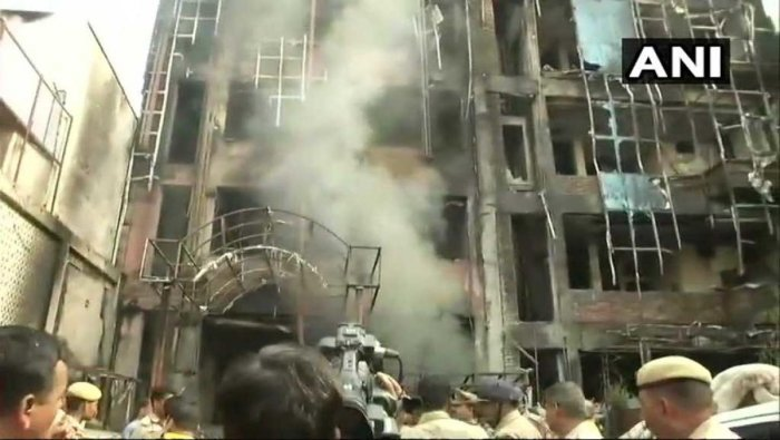 The fire broke out at the two hotels in Charbagh's Doodh Mandi area around 6 am, they said. (Image courtesy ANI/Twitter)