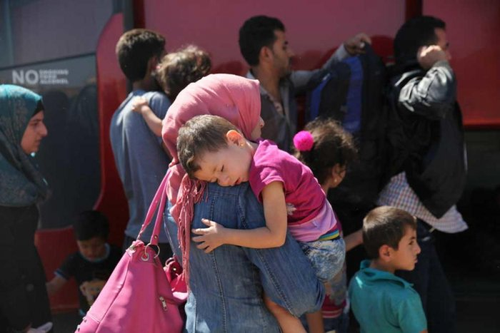 More than 1,100 people were inside the large, dark facility, which is divided into separate wings for unaccompanied children, adults on their own, and mothers and fathers with children. (Reuters file photo)