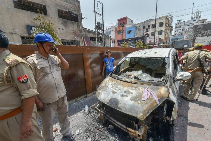 Fire personnel near Hotel Virat International where a fire broke out, in Lucknow on Tuesday. PTI