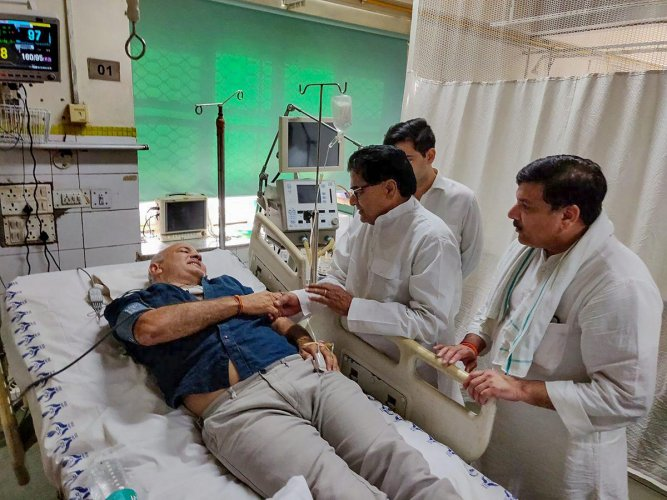 Samajwadi Party leader Ram Gopal Yadav along with AAP MP Sanjay Singh visits Deputy Chief Minister Manish Sisodia who is hospitalized at LNJP Hospital in New Delhi on Monday, June 18, 2018. Sisodia was on a hunger strike at Lt Governor's residence. (@AamAadmiParty via PTI Photo)