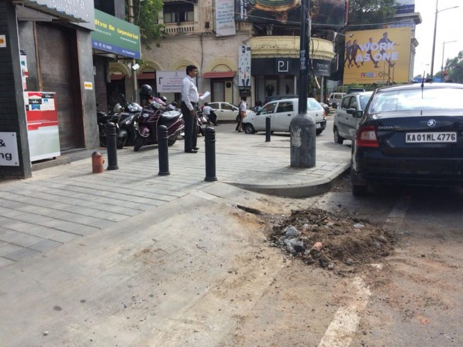 A portion of the footpath on MG Road was partially dug up to plug water leakage.