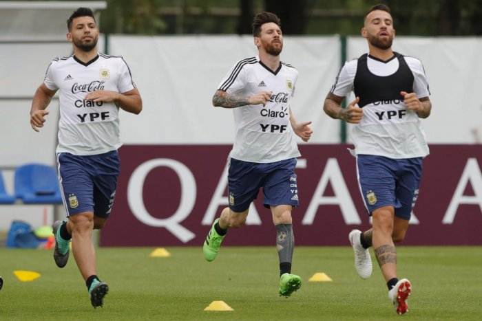 From left to right, Sergio Aguero, Lionel Messi and Nicolas Otamendi jog during a training session of Argentina at the 2018 soccer World Cup in Bronnitsy, Russia on Tuesday. (AP/PTI)