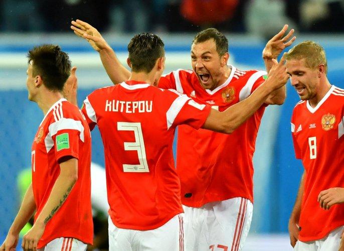 Russia's Artem Dzyuba celebrates scoring their third goal with team mates. REUTERS