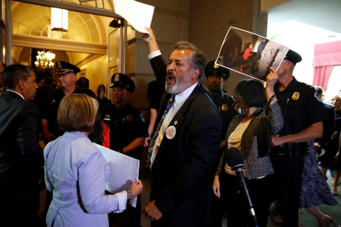 Rep. Juan Vargas (D-CA) and other Democratic members of Congress protest family separations at the US-Mexico border as US President Donald Trump departs after addressing a closed House Republican Conference meeting on Capitol Hill, in Washington. (REUTERS/Joshua Roberts)