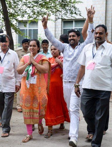 Aishwarya B N, the JD(S) candidate, with her supporters after winning the Binnypet bypoll. dh photo