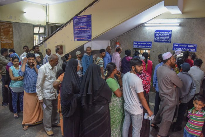 People wait in a queue at the Government Dental College and Research Institute. DH PHOTO/S K Dinesh