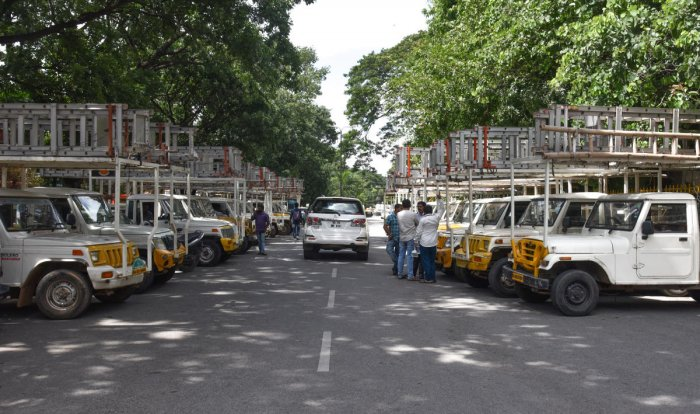 Streetlight maintenance contractors park their vehicles at the BBMP offices as part of a protest for payment of dues in Bengaluru on Wednesday. DH PHOTO/S K DINESH