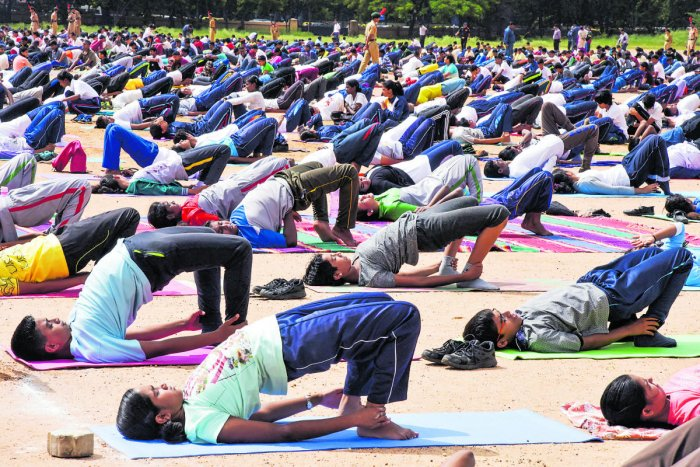 NCC cadets practise yoga at the Manekshaw Parade Ground on Wednesday. DH Photo/S K Dinesh