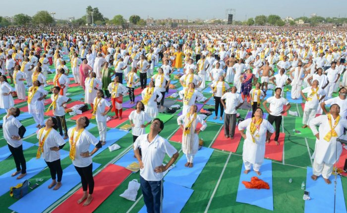 Yoga enthusiasts perform during an event by Guru Ramdev Baba and Rajasthan Chief Minister Vasundhara Raje to set the Guinness World Record for 'The Largest Yoga Lesson' during the International Day of Yoga, in Kota. PTI photo.