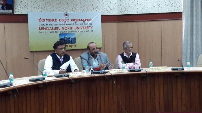Prof T D Kemparaju (centre), vice-chancellor of Bengaluru North University, addressing the press conference. Prof M S Reddy (right), registrar, and Prof Sundar Raj Urs, registrar (evaluation) are also seen. DH Photo
