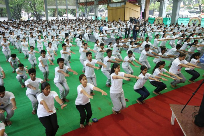 Yoga being performed during International Day of Yoga programme at Dharmasthala on Thursday.