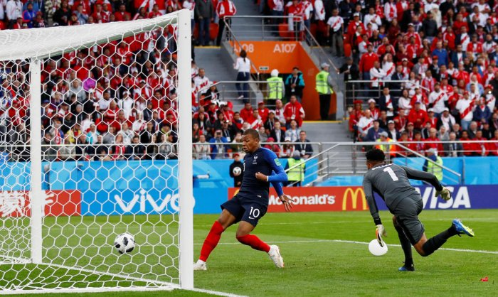 MEMORABLE DAY France's Kylian Mbappe (left) taps home from close range during their Group C clash against Peru on Thursday. REUTERS