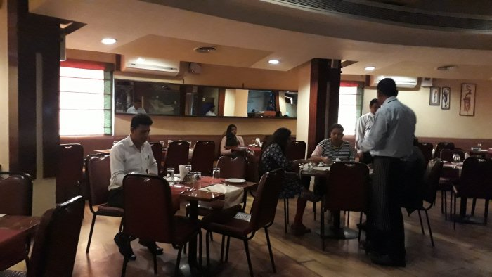 Restraunt owners believe that lone diners, like this one at Coast to Coast on M G Road, are an asset as they appreciate their space and food, and come back for the experience.