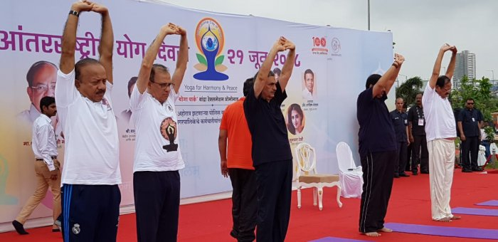 Vice President M Venkaiah Naidu and Maharashtra CM Devendra Fadnavis at the yoga day celebrations in Mumbai. (DH Photo)