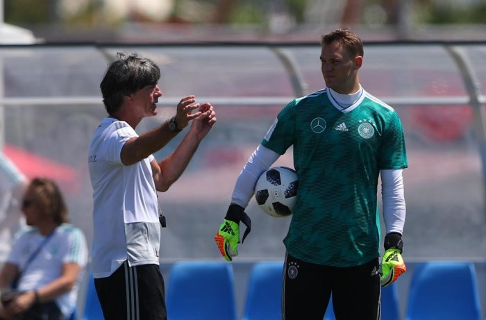 LET'S TRY THIS... Germany's coach Joachim Loew has a chat with goalkeeper Manuel Neuer during a training session. REUTERS