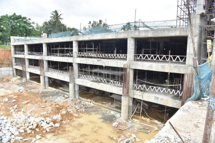 Construction work under way at the multi-level parking lot at Freedom Park, on Thursday. DH Photo/ Janardhan B K