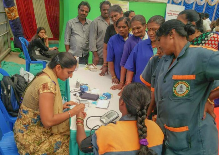 BBMP employees at a health check-up camp at the civic body's headquarters in Bengaluru on Thursday.