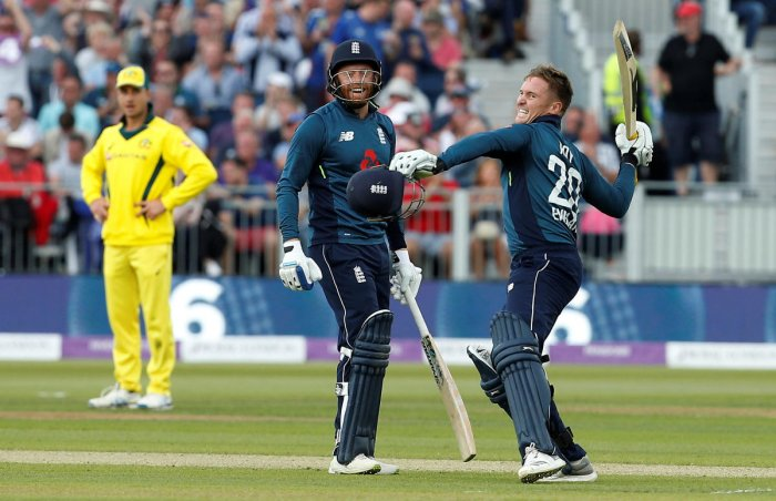 England's Jason Roy celebrates with Jonny Bairstow after reaching a century. (Reuters/Craig Brough)