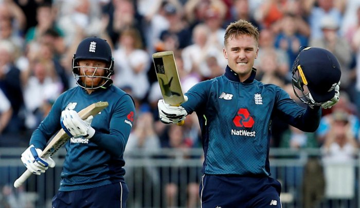 England's Jason Roy (right) celebrates after reaching his hundred against Australia as team-mate Jonny Bairstow looks on. Reuters