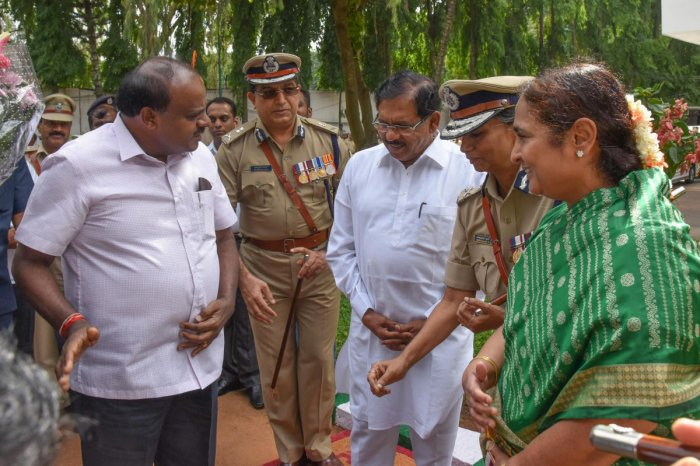 Chief Minister H D Kumaraswamy and Deputy Chief Minister G Parameshwara arrive for a meeting with senior police officers at the state police head quarters in Bengaluru on Friday. (From right) Chief Secretary Ratna Prabha, DG&IGP Neelmani Raju and ADGP