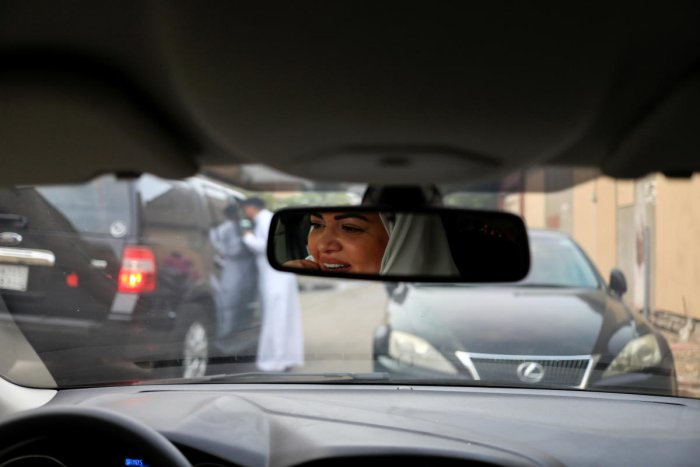 Dr Samira al-Ghamdi, 47, a practising psychologist, drives around the side roads of a neighbourhood as she prepares to hit the road on Sunday as a licensed driver, in Jeddah. Reuters photo
