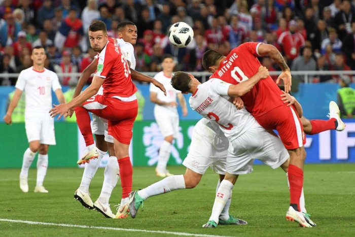 Serbia's forward Aleksandar Mitrovic (right) is held by Switzerland's Stephan Lichtsteiner and Fabian Schar in the penalty area. AFP